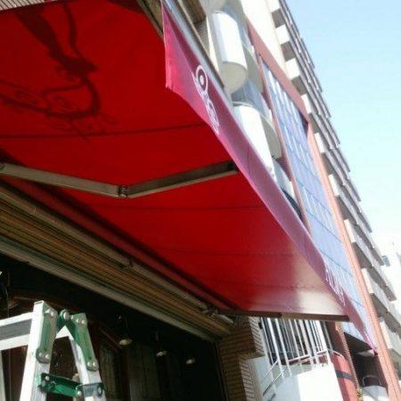 東京都渋谷区|オーニングテントの生地張替えの施工事例(飲食店)